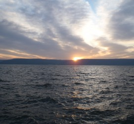 The sun rising over the Golan Heights across the Sea of Galilee - 2012